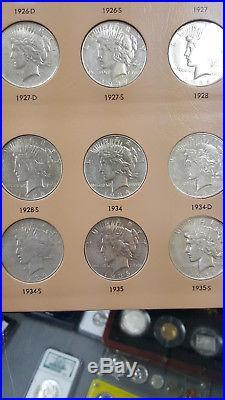 DANSCO ALBUM COMPLETE SET OF AU PEACE DOLLARS 1921-1935. All mintmarks 24 coins